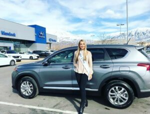 Jesse Craig in front of Hyundai Santa Fe